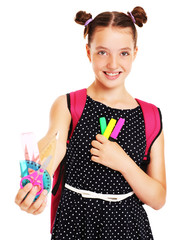 Happy schoolgirl with set of school stationary