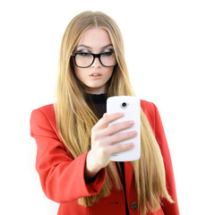 fashion blond girl in glasses make photos with mobile phone, ove