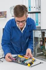 Young technician working on broken cpu