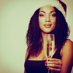 christmas young beautiful mulatto woman smiling with champagne a