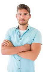 Handsome young man posing with arms crossed