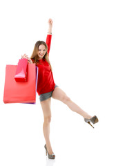 Beautiful excited teen girl with shopping bags. Full length port