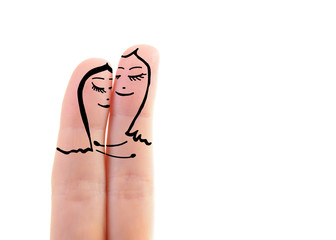 two fingers like a two women embracing in love over pink backgro