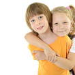 Happy smiling little boy and girl. Portrait of cute embracing li