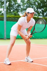 Focused tennis player ready for match