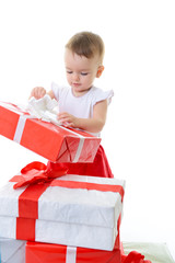 Holidays, baby girl opening box with presents, christmas, birthd