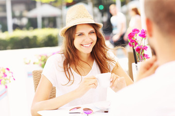 Happy woman in a cafe