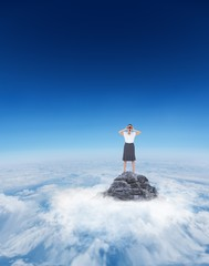 Composite image of woman on a mountain top