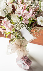 gift and flowers on table