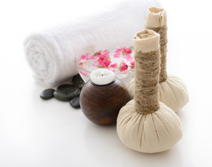 spa still life with spa herbal balls, candlestick, roses, stones