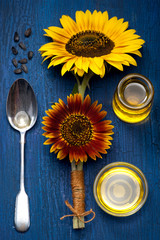 Sunflower oil and sunflower flowers