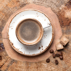Coffee cup on wooden vintage background