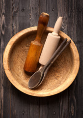 Rustic wooden bowl, rolling pin and wooden spoons