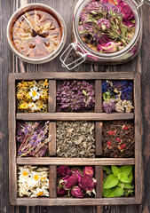 Dried herbs in vintage box and tea