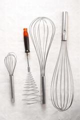 close up kitchen utensil on white paper