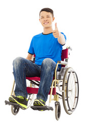 happy young man sitting on a wheelchair and thumb up