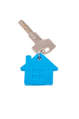 a key with house shaped keyring on white
