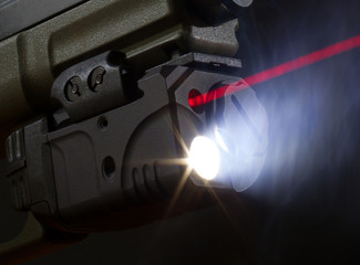 Laser aiming on a handgun