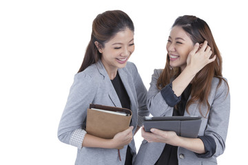 Two beautiful businesswomen working