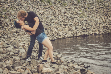 happy loving couple on the river bank