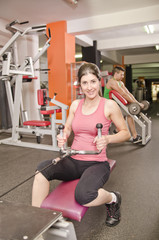 Woman ready for rowing train ( back muscles)
