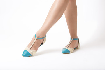 Woman's Legs Wearing Turquoise Shoes