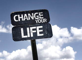 Change your Life sign with clouds and sky background