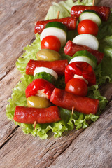 hot grilled sausages with vegetables on skewers vertical