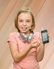 Girl with headphones and a telephone.