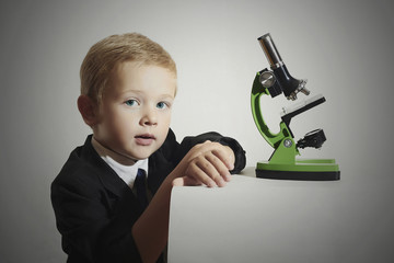 child.little scientist.Schoolboy with a microscope.Education