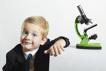 little scientist.little boy in tie.funny child with a microscope