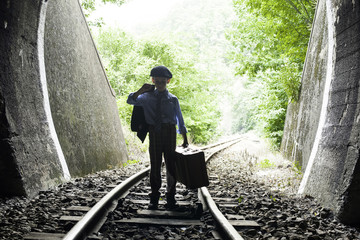 Child walking on railway road