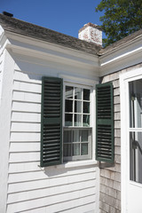 White Cape Cod house with green shutters in Massachusetts