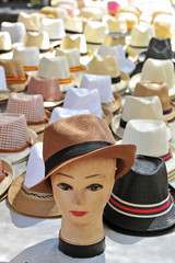 Cheap hats in the market of the town