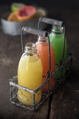 Glass bottles of assorted fresh fruit juice