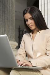 businesswoman typing laptop