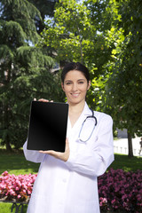 doctor woman showing tablet screen