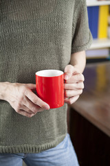 hand red coffee cup
