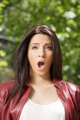 pretty woman open mouth face with red leather jacket