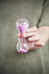 pink sand clock in hand
