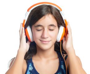 Hispanic teenage girl enjoying music on headphones