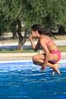 Girl jump in the pool