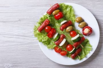 grilled sausages with vegetables on a plate top view