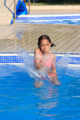 Girl jump in the pool