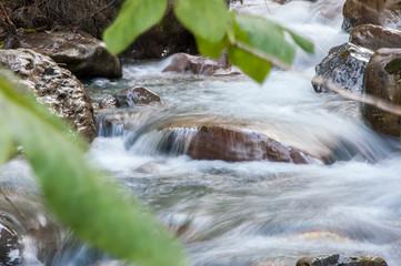 little stream flowing between the rocks