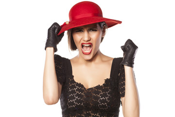 angry woman with a red hat and leather gloves