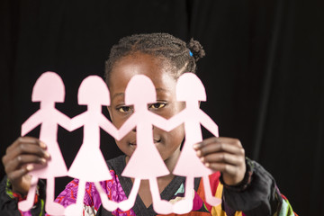 Black girl playing with dolls
