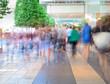 Motion blurred crowd walking