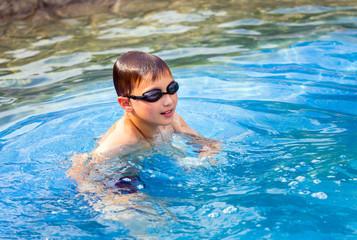 Ten year old boy in swimming pool