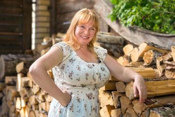Portrait of a women near woodpile